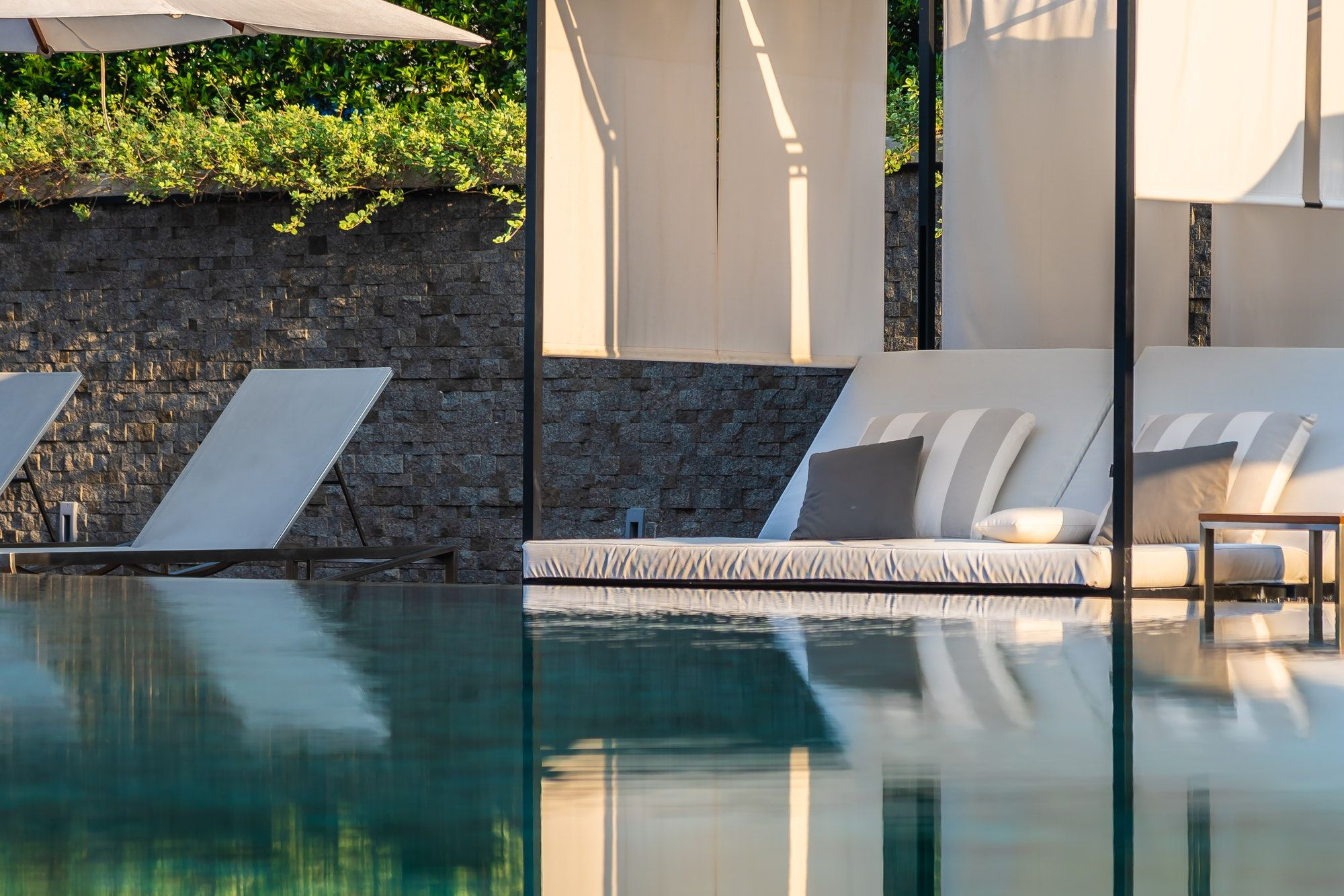outdoor-swimming-pool-with-umbrella-chair-lounge-around-there-fo.jpg