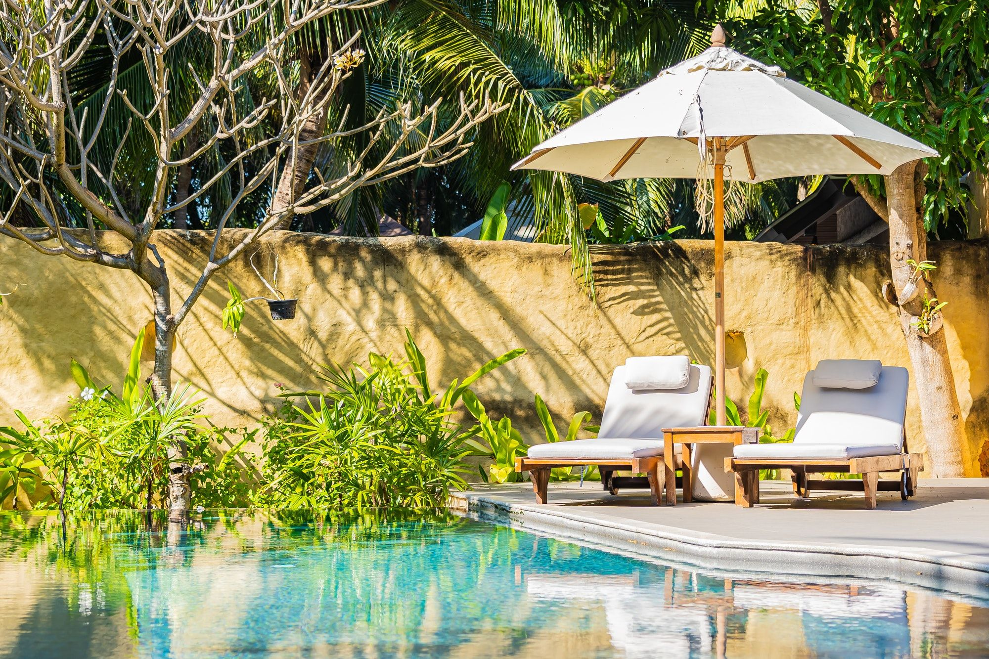 umbrella-and-chair-around-outdoor-swimming-pool.jpg